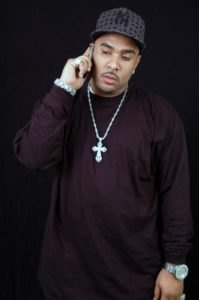 Photo of rapper Big fsce Mike on the mobile phone