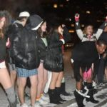 Girls and guys with No pants boarding a subway