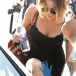 Photo of Miley Cyrus upskirt picture in black mini dress getting in car
