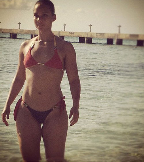 Photo of Alicia Keys in 2 piece bikini with hair pulled back - June 2012