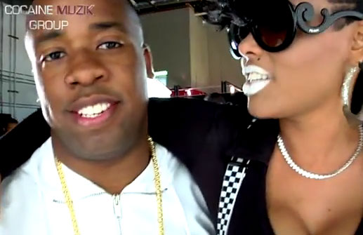Photo of Yo Gotti with Keyshia Kaoir behind the scenes at Got Dat Sack video shoot