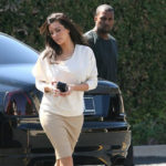 Celebrity couple Kim Kardashian and Kanye West getting out of car