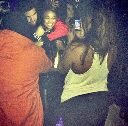 Drake hugs up with Tatyana Ali during her birthday party