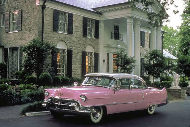 Photo of Elvis pink Cadillac in front of Graceland mansion
