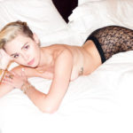 Photo of Miley Cyrus topless in bed