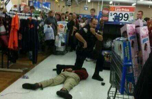 Police Pins Down Walmart Shopper During Walmart Brawl