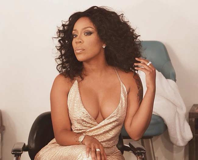 K Michelle gold gown