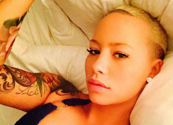 Amber Rose in bed