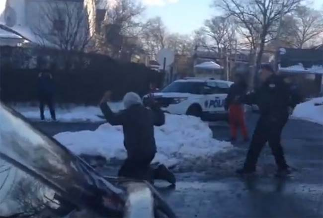 police pulls gun on teens throwing snowballs