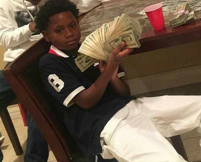 Baby CEO Memphis rapper hand full of cash