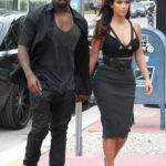 Photo of Kanye West, Kim Kardashian in see through skirt
