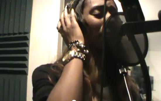 Photo of Latanfernee Hardaway singing in the studio booth
