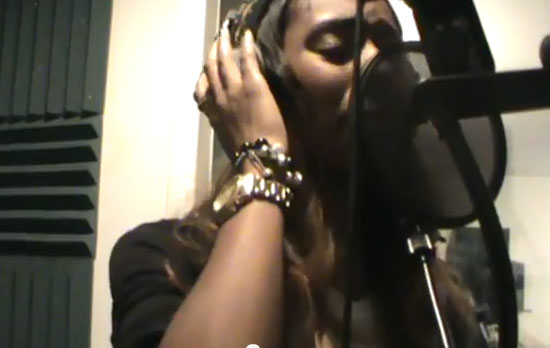 Photo of Latanfernee Hardaway singing in the studio booth