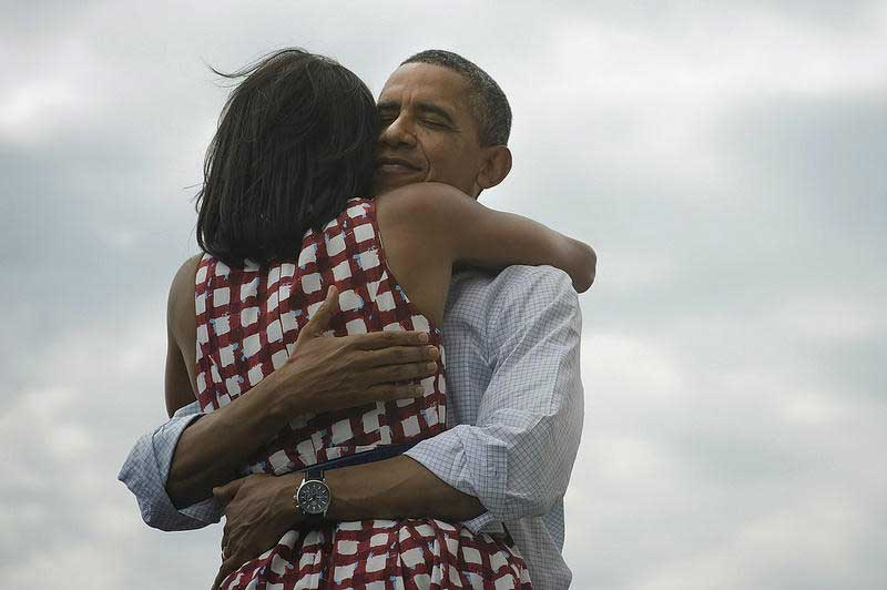 Photo of Barack and Michelle Obama Hugging - Four More Years