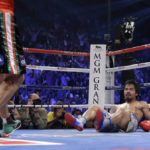 Juan Manuel Marquez knocks Manny Pacquiao on the mat