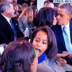 Photo of Sasha and Malia during Michelle, Barack Obama kissing picture