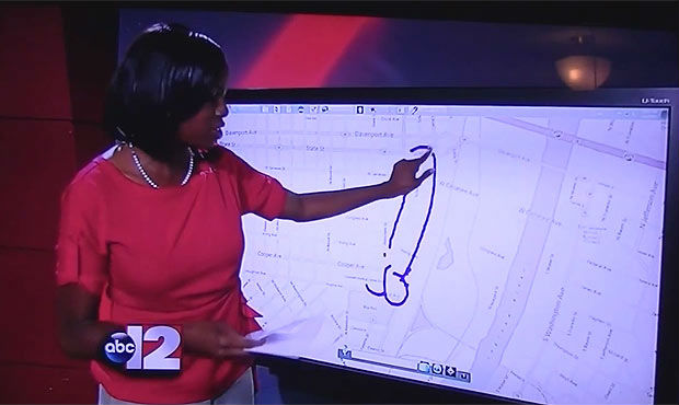 Photo of News Reporter Siobhan Riley Drawing Penis on map of Saginaw Michigan