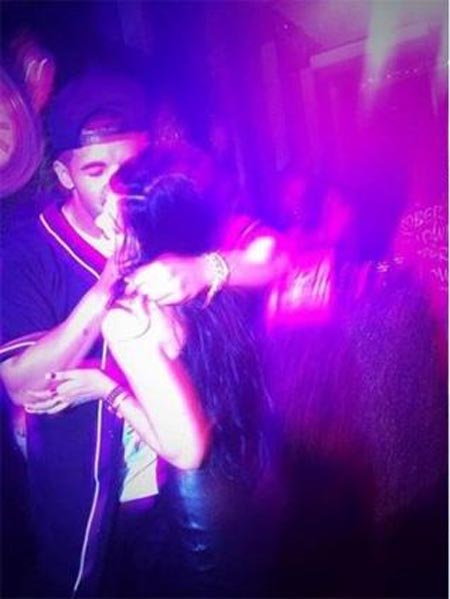 Kylie Jenner gets a kiss from rapper Drake at Sweet 16 Birthday Bash