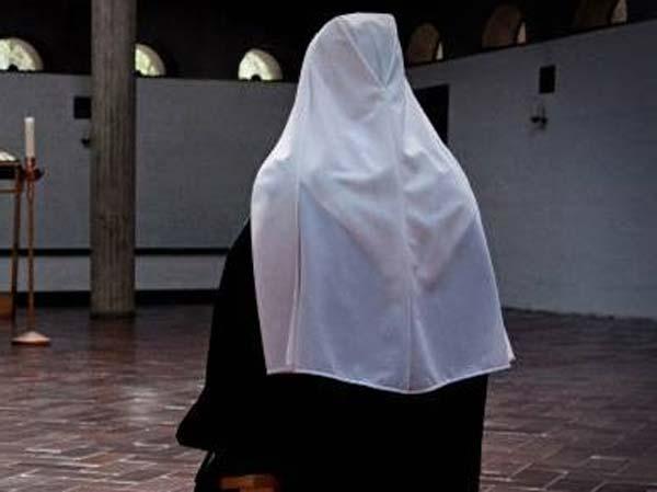 Nun Prays