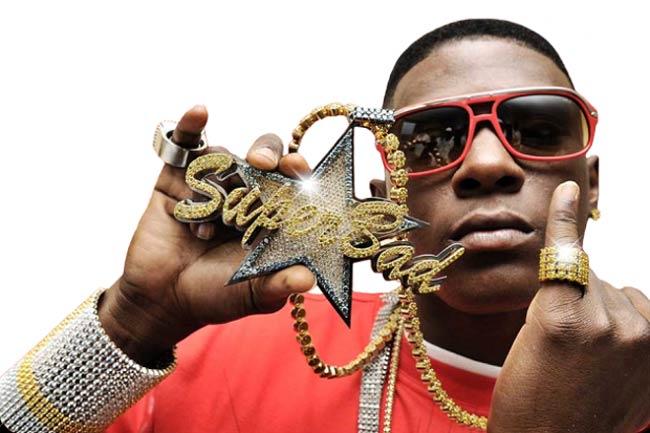 Lil Boosie holding Super Bad chain in hand
