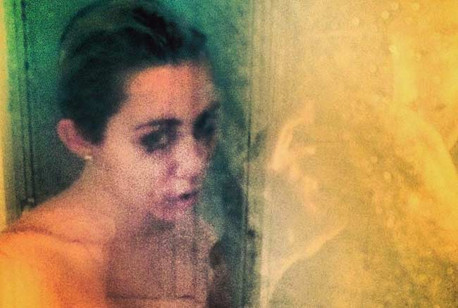 Miley Cyrus making dripping shower