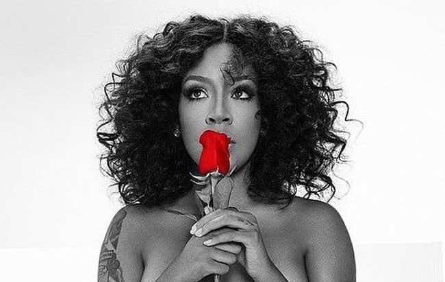 K Michelle holding rose